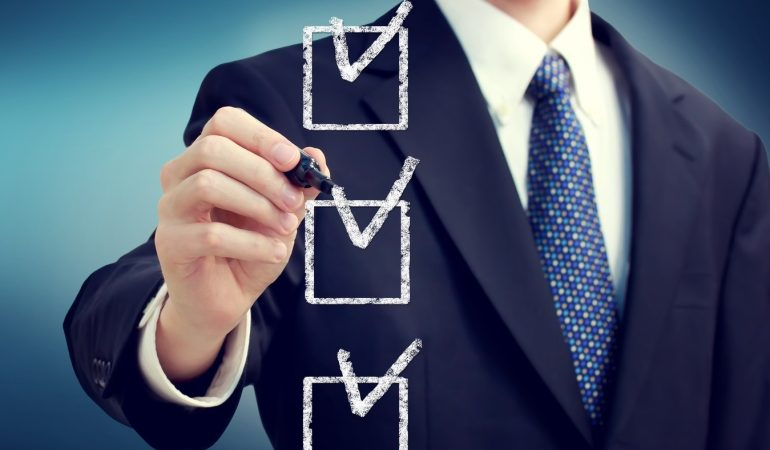 Business man with check boxes over navy blue background